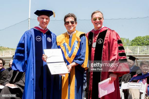 Founder and CEO of Shutterstock Jon Oringer receives an honorary degree of Doctor of Science during the Stony Brook University 2017 Commencement at...