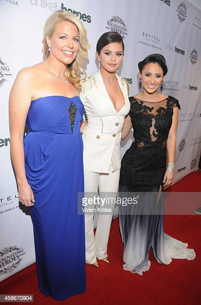 Founder and CEO of Unlikely Heroes Erica Greve actress / singer Selena Gomez and actress Francia Raisa attend the Unlikely Heroes' 3rd Annual Awards...