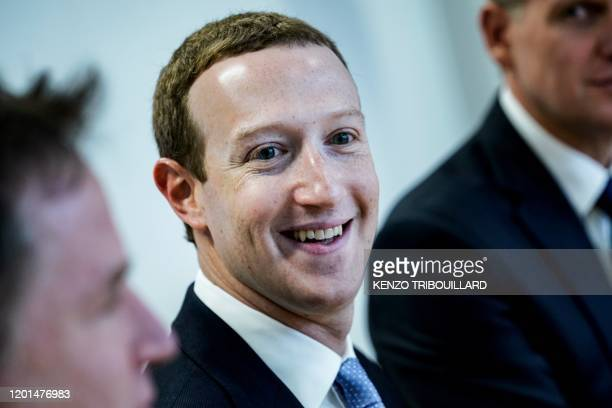 Founder and CEO of US online social media and social networking service Facebook Mark Zuckerberg reacts upon his arrival for a meeting with European...