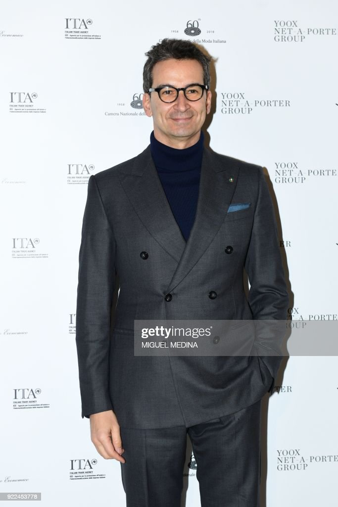 Founder and CEO of Yoox Federico Marchetti, poses upon the arrival to the exhibition preview of 'Italiana, Italy Through the Lens of Fashion' at Palazzo Reale in Milan, on February 21, 2018. / AFP PHOTO / Miguel MEDINA