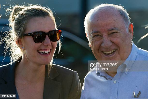 Founder and chairman of the Inditex fashion group Amancio Ortega laughs with his daughter Marta Ortega at the end of the 32nd edition of the A Coruna...