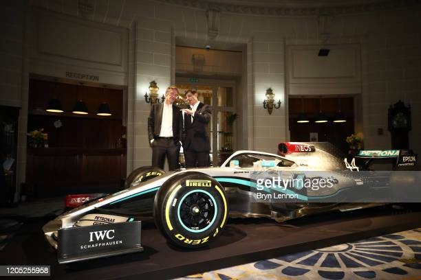 Founder and Chairman Sir Jim Ratcliffe and Toto Wolff Team Principal CEO of The Mercedes AMGPETRONAS F1 Team speak next to a Mercedes F1 car and it's...