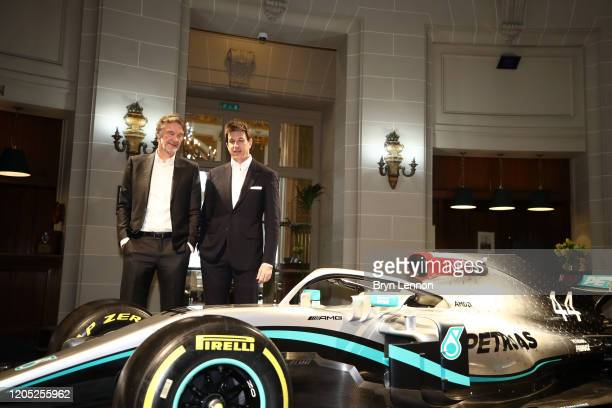 Founder and Chairman Sir Jim Ratcliffe and Toto Wolff, Team Principal & CEO of The Mercedes AMG-PETRONAS F1 Team speak next to a Mercedes F1 car and...