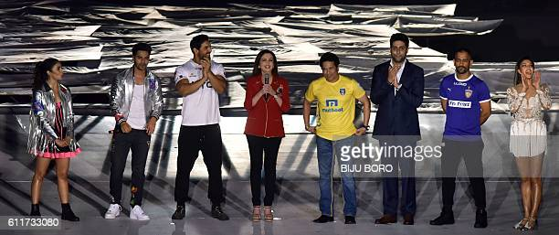 Founder and Chairperson Indian Super League Nita Ambani is watched by Bollywood actors Varun Dhawan John Abraham Abhishek Bachchan and former Indian...