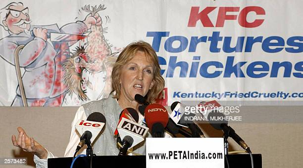 Founder and director of People for the Ethical Treatment of Animals Ingrid Newkrik addresses a press conference in Bangalore 09 October 2003 as she...