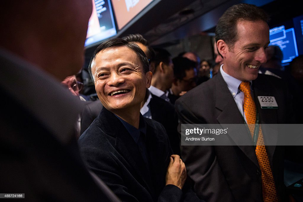 Founder and Executive Chairman of Alibaba Group Jack Ma (L) attends the company's initial price offering (IPO) at the New York Stock Exchange on September 19, 2014 in New York City. The New York Times reported yesterday that Alibaba had raised $21.8 Billion in their initial public offering so far.