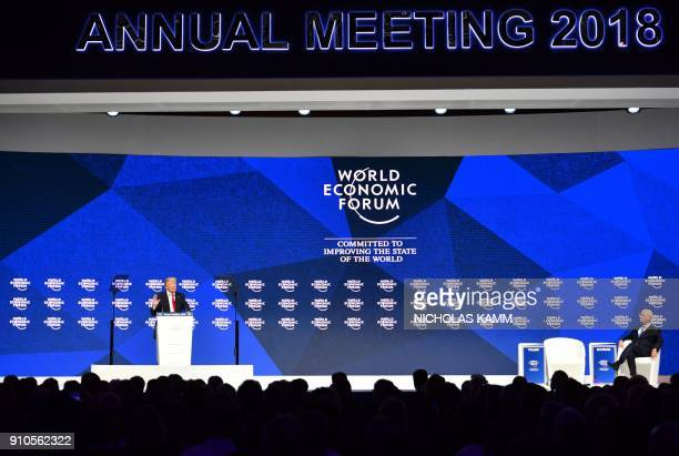 Founder and Executive Chairman of the World Economic Forum Klaus Schwab listens as US President Donald Trump delivers a speech during the World...