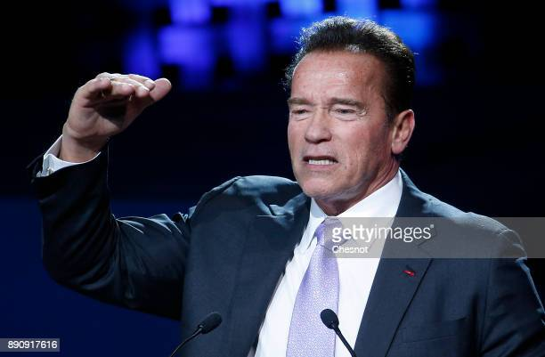 Founder and former California state governor Arnold Schwarzenegger delivers a speech during the One Planet Summit at the Seine Musicale on December...