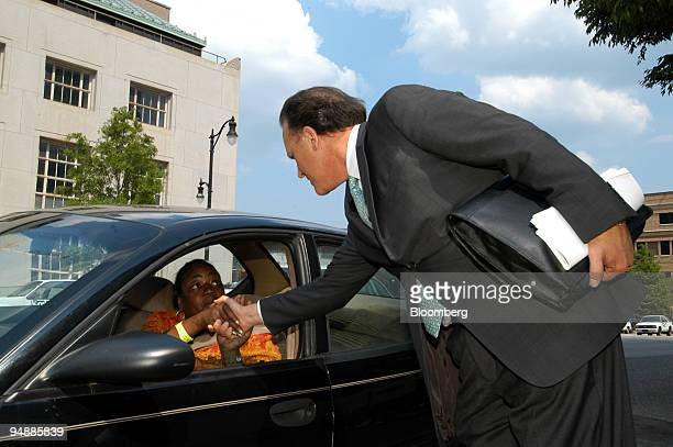 Founder and former CEO of HealthSouth Corp Richard Scrushy talks with supporter Mona Beck outside the Hugo Black Federal Courthouse during jury...