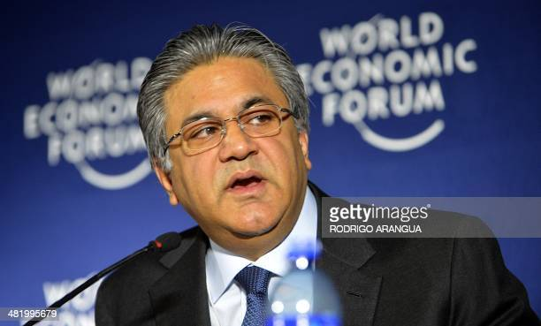 Founder and Group Chief Executive of The Abraaj Group Pakistani Arif Naqvi speaks during a press conference next to the Executive Director of the...