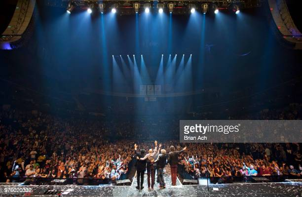 Founder and guitarist Neal Schon drummer Steve Smith singer Arnel Pineda bassist Ross Valory and keyboardist Jonathan Cain of the band Journey are...
