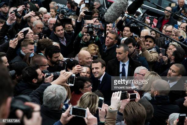 Founder and Leader of the political movement 'En Marche !' and presidential candidate Emmanuel Macron poses for a selfie as he arrives to vote in the...