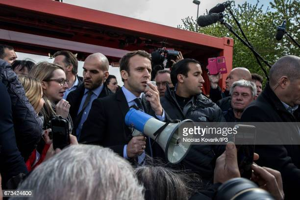 Founder and Leader of the political movement 'En Marche ' and presidential candidate Emmanuel Macron meets the employees of Whirlpool who whistle and...