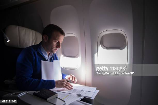 Founder and Leader of the political movement 'En Marche ' and presidential candidate Emmanuel Macron reread his files on the plane to Pointe a Pitre...