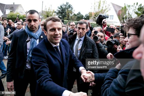 Founder and Leader of the political movement 'En Marche !' and presidential candidate Emmanuel Macron goes to vote for the second round of the...