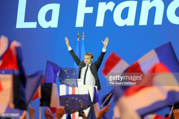 Founder and Leader of the political movement 'En Marche ' Emmanuel Macron waves after winning the lead percentage of votes in the first round of the...