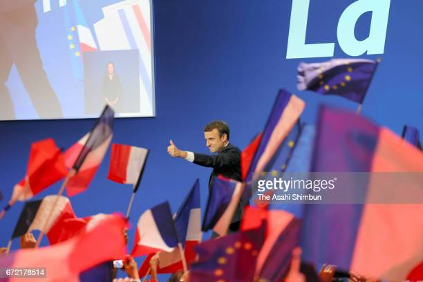 Founder and Leader of the political movement 'En Marche ' Emmanuel Macron thumbs up to his supporters after winning the lead percentage of votes in...