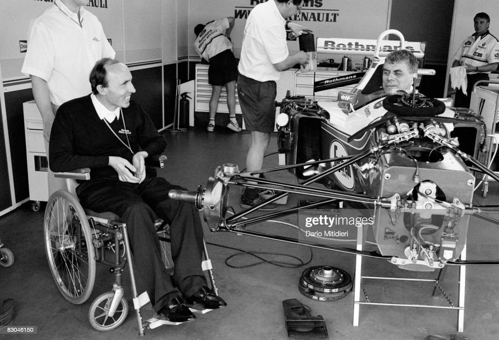Founder and manager of the Williams F1 Racing team Frank Williams talks to team mechanics during a qualifying round of the San Marino Grand Prix on the Imola Circuit, Imola, Italy, 30th April 1994. Williams was charged with manslaughter after team driver Ayrton Senna died during the race on May 1st.