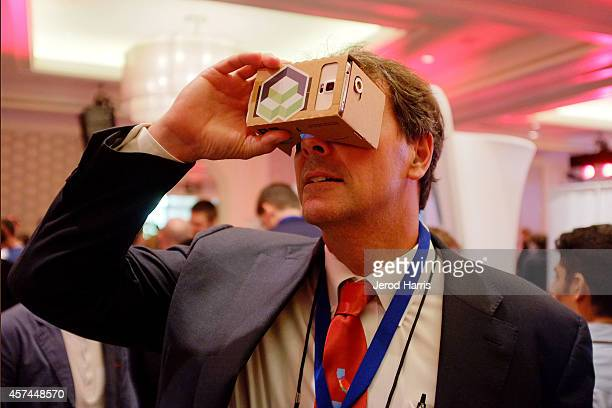 Founder and Managing partner of 'Draper Fisher Jurvetson' Tim Draper tries out the latest in virtual reality technology the 2014 Kairos Global Summit...