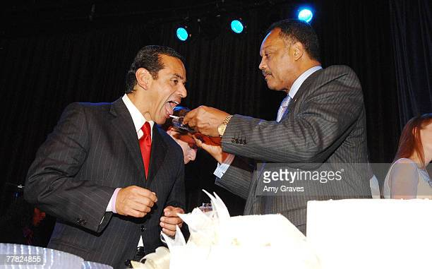 Founder and President of the Rainbow PUSH Coalition Reverend Jesse Jackson Sr feeds birthday cake to Los Angeles City Mayor Antonio Villaraigosa at...