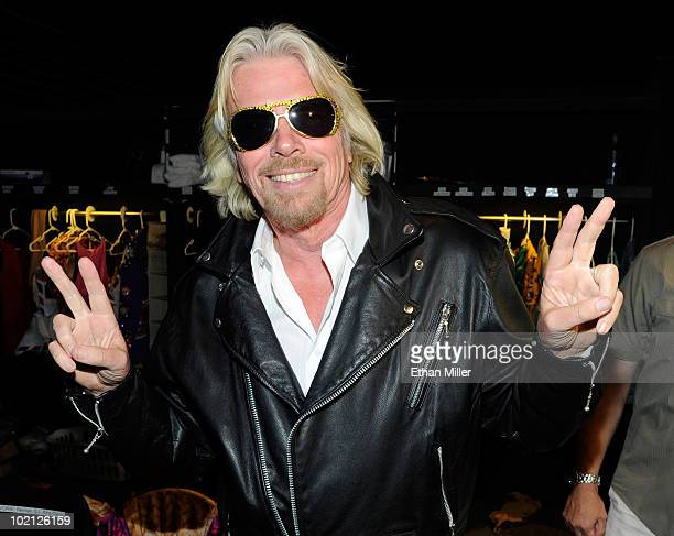 Founder and President of Virgin Group Sir Richard Branson puts on a leather jacket backstage at the Viva ELVIS production by Cirque du Soleil at the...