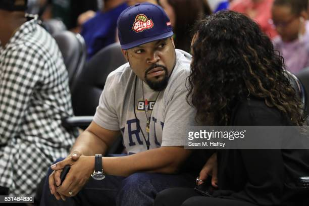 BIG3 founder and recording artist Ice Cube sits with his wife Kimberly Woodruff during week eight of the BIG3 three on three basketball league at...