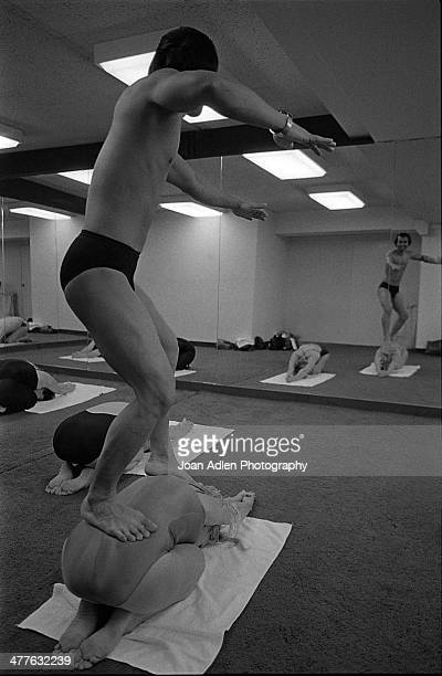 Founder and teacher of Bikram Yoga Bikram Choudhury assists actress Carol Lynley with the 'Half Tortoise Pose' at his yoga studio in Beverly Hills...