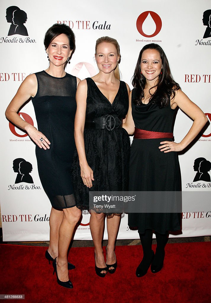 Founder & CEO of Noodle & Boo Christine Burger, Singer/songwriter Jewel, and Founder and President of Blood:Water Mission Jena Nardella attend the Red Tie Gala Hosted by Blood:Water Mission and sponsored by Noodle & Boo at Hutton Hotel on November 21, 2013 in Nashville, Tennessee.