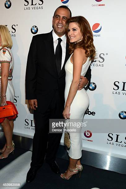 Founder Chairman and CEO of sbe Sam Nazarian and television personality Maria Menounos attend the SLS Las Vegas grand opening celebration on August...