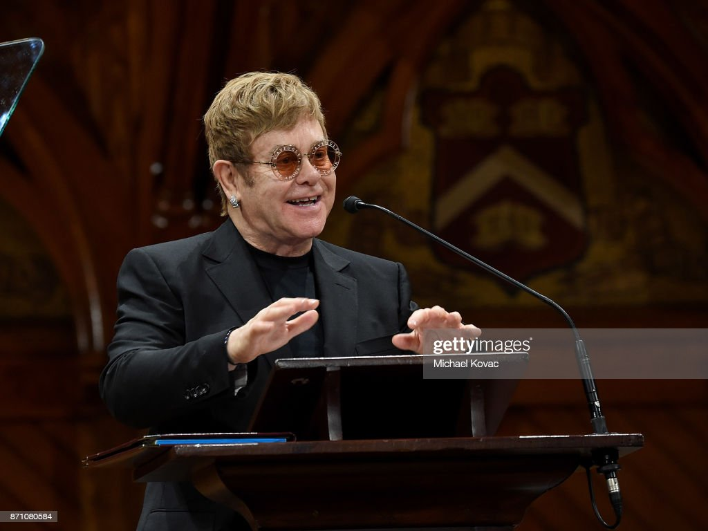 EJAF founder Elton John presents onstage as he accepts the Peter J. Gomes Humanitarian of the Year Award from the Harvard Foundation for his work towards ending AIDS at Sanders Theatre on November 6, 2017 in Cambridge, Massachusetts.