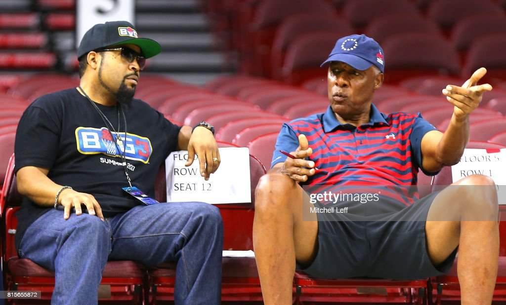 Founder Ice Cube speaks to coach Julius 'Dr. J' Erving before week four of the BIG3 three on three basketball league at Wells Fargo Center on July 16, 2017 in Philadelphia, Pennsylvania.