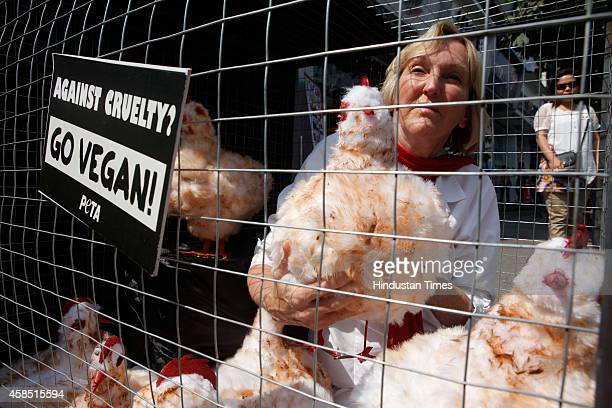 PETA founder Ingrid Newkirk caged herself with some dummy chicken to portray the conditions of chicken which are slaughtered for World Vegan Month at...