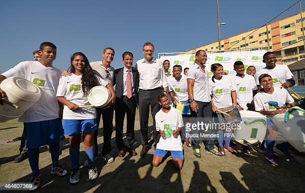 Founder jorginho LOC Member Bebeto FIFA Secretary General Jerome Valcke and brazilian former player Cafu pose for photo with children at the football...
