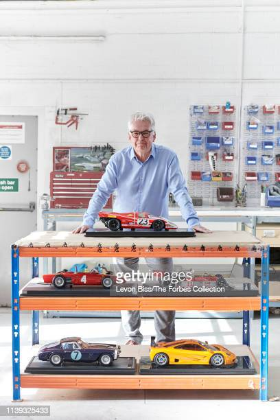 Founder of Amalgam Sandy Copeman is photographed for Forbes Magazine on March 14 2019 in Bristol England Copeman with 18 models of a Porsche 917k F1...