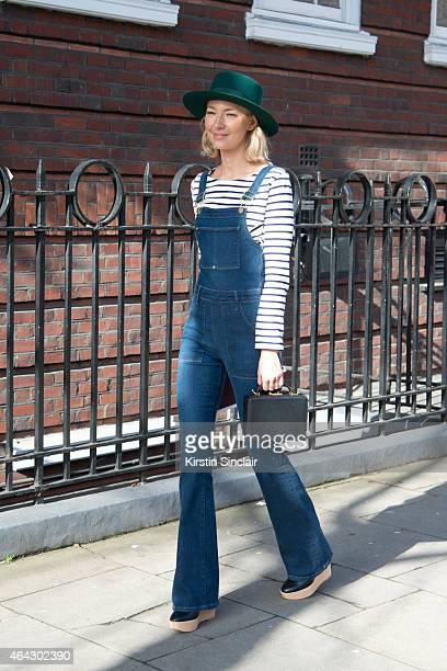 Founder of Avenue 32 Roberta Benteler wears Frame denim dungerees Marc Cross bag Petit Bateau top on February 23 2015 in London England