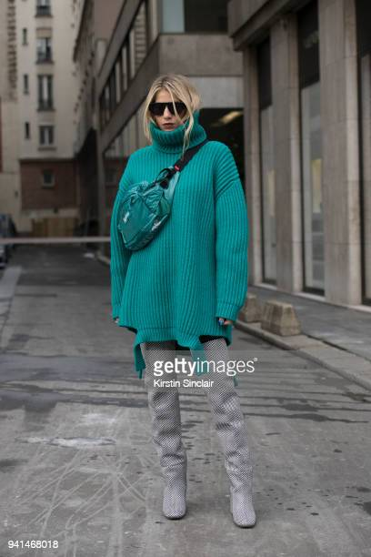 Founder of Beyond the maga Sophia Macks wears a Supreme bag Balenciaga knitted jumper Karen Walker sunglasses and Stuart Weitzman boots day 4 of...
