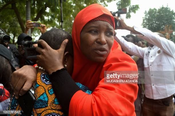 Founder of Bring Back Our Girls advocacy group Oby Ezekwesili is comforted by Aisha Yesufu a member of the group during a protest in the Nigerian...