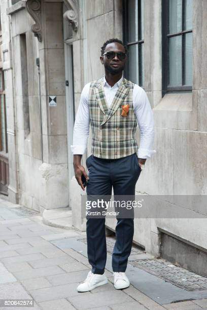 Founder of cutsforhimcom Edmund Kamara wears a Suit Supply waistcoat trainers and trousers Hudsons of London pocket square Tom Ford sunglasses and a...