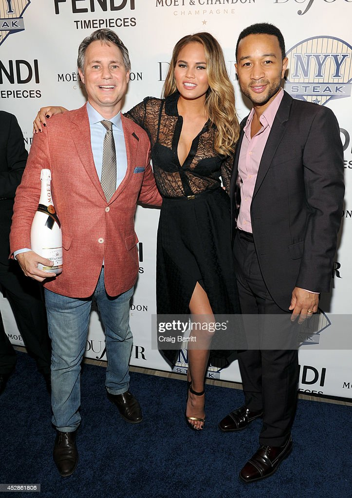Founder of DuJour Media Group Jason Binn, model Chrissy Teigen and singer-songwriter John Legend attend DuJour Magazine and NYY Steak celebrating Chrissy Teigen with FENDI timepieces and Moet Ice on July 28, 2014 in New York City.