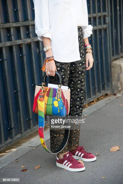 Founder of fashion blog manrepellercom Leandra Medine Cohen wears a Dior bag Chanel trousers and adidas trainers day 1 of Paris Womens Fashion Week...