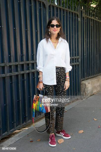 Founder of fashion blog manrepellercom Leandra Medine Cohen wears a Dior bag Chanel trousers Celine sunglasses and adidas trainers day 1 of Paris...