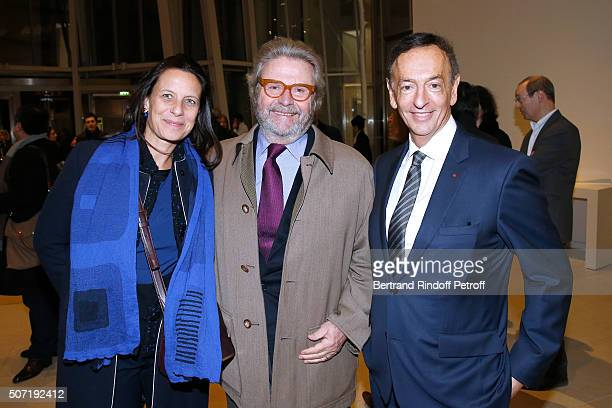 Founder of 'Fondation Cartier' Alain Dominique Perrin standing between his daughter Director of Development at the Fondation Cartier Sonia Perrin and...