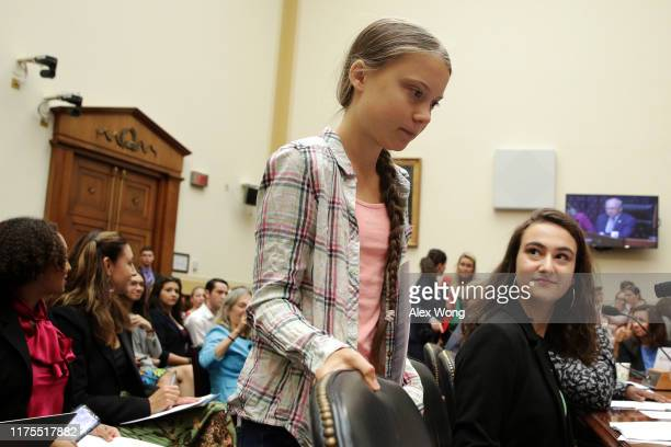 Founder of Fridays For Future Greta Thunberg takes her seat as cofounder of This Is Zero Hour and plaintiff in Piper v State of Washington Jamie...
