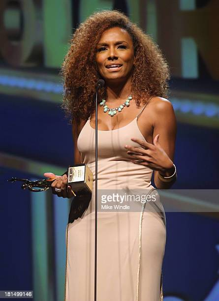 Founder of #GIRLSLIKEUS Janet Mock speaks on stage at the ADCOLOR Awards at The Beverly Hilton Hotel on September 21 2013 in Beverly Hills California