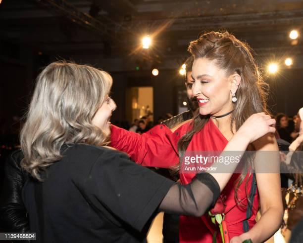 Founder of Jordan Fashion Week Shirene Rifai embraces a guest at Jordan Fashion Week 019 on March 30 2019 at the Kempinski Amman in Amman Jordan