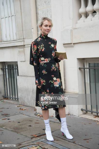 Founder of Kuznetsky Most 20 concept store Olga Karput wears a Valentino dress and Vetements boots day 6 of Paris Womens Fashion Week Spring/Summer...