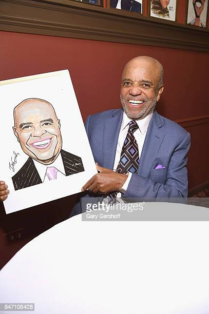 Founder of Motown Records Berry Gordy poses with his portrait at Sardi's on July 13 2016 in New York City