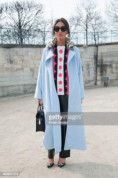 Founder of NDuoConcept Natuka Karkashadze wears Missoni sunglasses Corta Morltedo bag Gianvito Rossi shoes Story of Lola coat Valentino top and Maje...