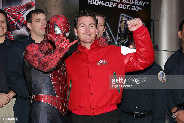 Founder of Papa John's John Schnatter poses with a SpiderMan impersonator onstage at the SpiderMan and Papa John's Pizza's announcement of Hometown...