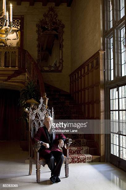Founder of Playboy Hugh Hefner poses at a portrait session at the Playboy Mansion in Los Angeles CA